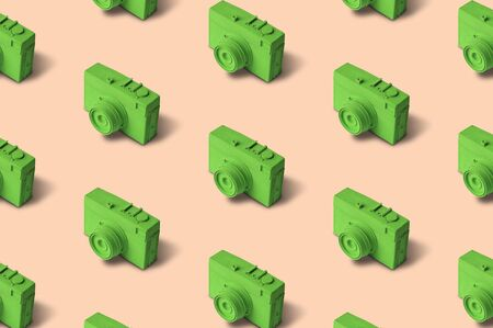 Green retro photo camera seamless pattern on pastel background. Banco de Imagens