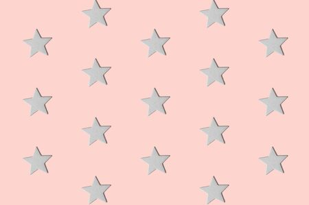 White decorative stars pattern on pastel pink background minimal creative concept. Banco de Imagens