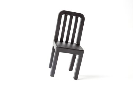 Black retro chair against white background minimal creative concept.