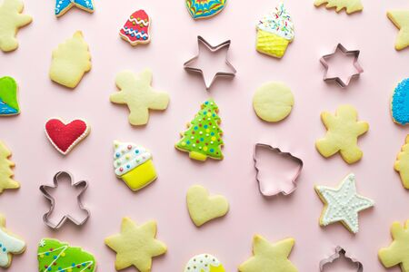 Flat lay christmas cookies pattern on pastel pink background minimal holiday creative concept.