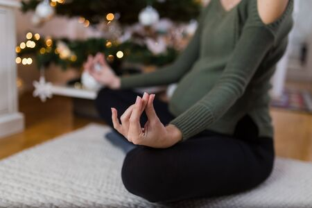 Practicing yoga during pregnancy. Christmas holiday and exercising concepts. Banco de Imagens