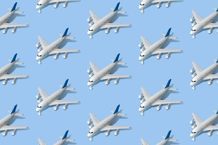 Commercial airplane pattern on pastel blue background minimal creative transportation and travel concept.