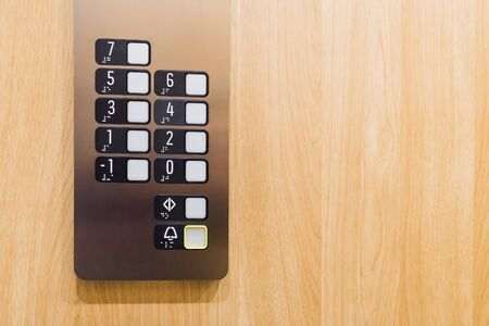 Close up of elevator control panel buttons. Space for copy.