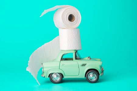 Car toy with toilet paper on roof covid 19 coronavirus supplies abstract.