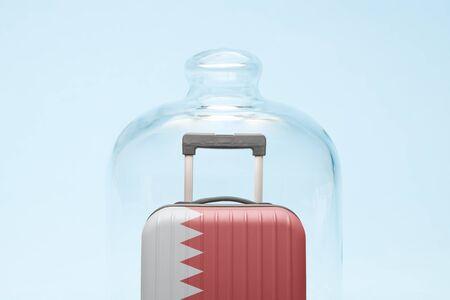 Suitcase with Bahrain flag design in quarantine minimal creative coronavirus travel restriction concept.