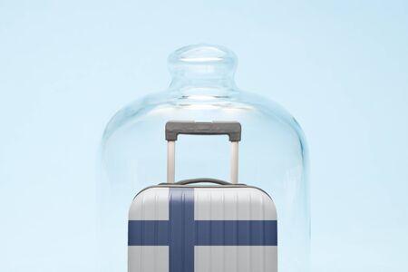 Suitcase with Finland flag design in quarantine minimal creative coronavirus travel restriction concept.