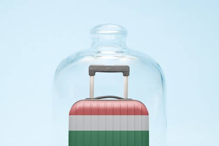 Suitcase with Hungarian flag design in quarantine minimal creative coronavirus travel restriction concept. Imagens