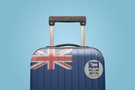 Suitcase with Falkland Islands flag design travel South America concept.