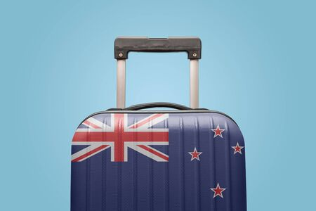 Suitcase with New Zealand flag design travel America concept.