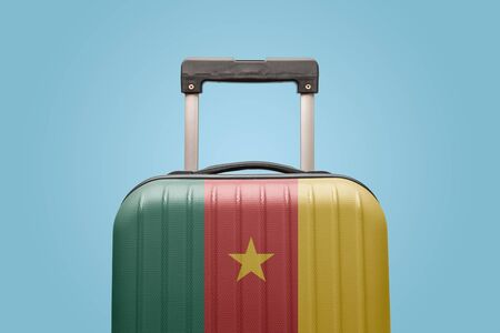 Suitcase with Cameroon flag design travel Africa concept.