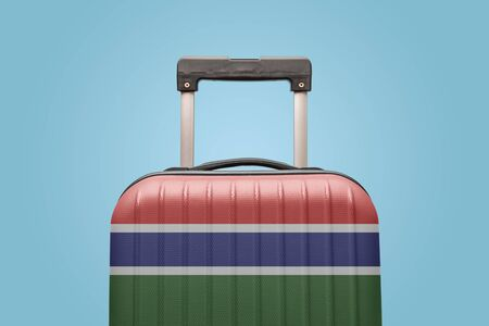Suitcase with Gambian flag design travel Africa concept. Stock Photo