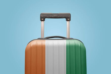 Suitcase with Ivory Coast flag design travel Africa concept. Stock Photo