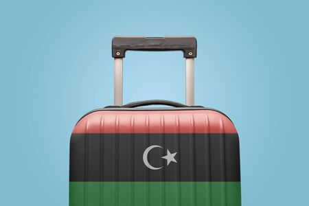 Suitcase with Libyan flag design travel Africa concept.