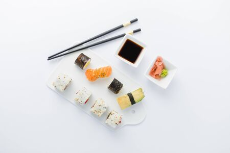 Flat lay of of japanese sushi set on white background. Space for copy. Stock Photo