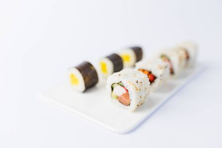 Sushi rolls and nigiri meal set with on table.