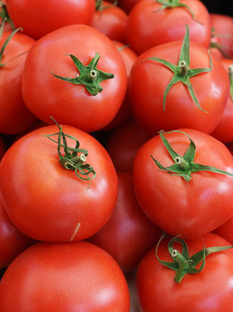 A box of red tomatoes sold on the market.