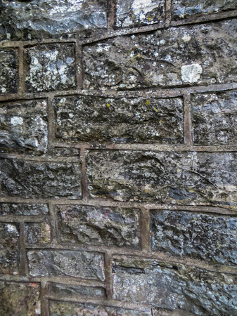 Decorative lined wall of gray, treated stones