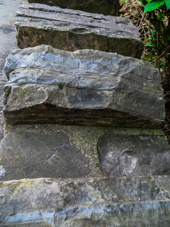 Decorative wall made of gray, rough stones