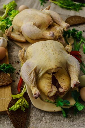 Two chicken from a home farm cooked for roasting in the oven