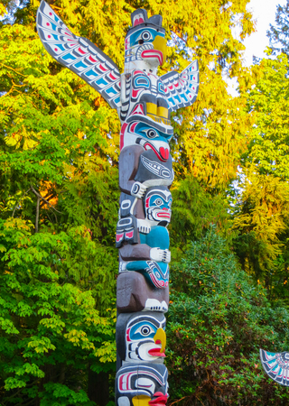 VANCOUVER, CANADA -september 2014: Wooden Haida Indian totem poles mark the boundary of the spirit world in Stanley Park, Vancouver, Canada