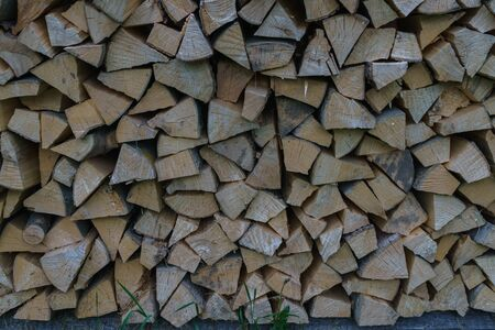 Fuel for stove heating at home and bath. Rural life. Wooden firewood is laid in the walls. Natural wood Reklamní fotografie