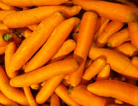 Fresh, grown in the village, orange carrots lying in a box Stock Photo - 134452758