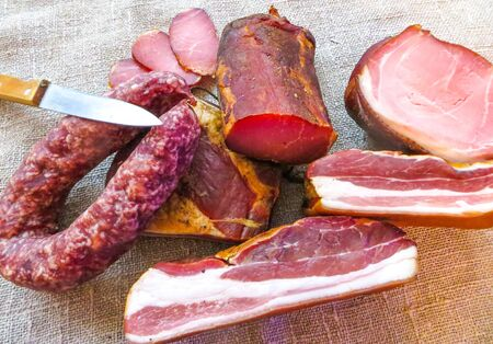Raw smoked meat, ham and sausage, cooked according to traditional recipes