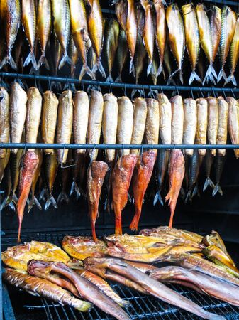 Smoked mackerel and flounder at the smelt holiday on the Baltic Sea in Palanga Stock Photo