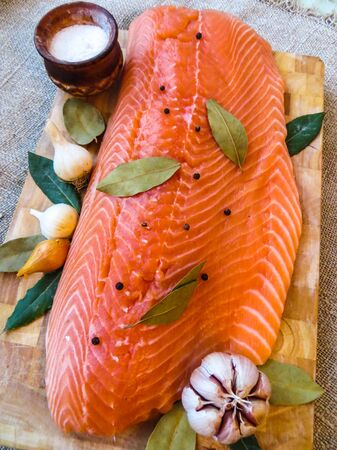salmon filet with bay leaf and spices.