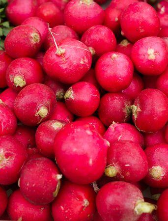 Fresh red radish lying in a box