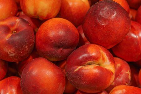 Fresh, ripe, juicy peaches in a box