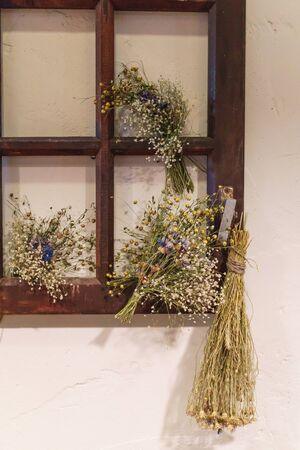 Beautiful scenery from an old window frame and dried flowers