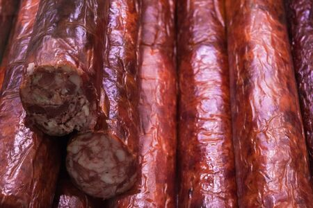 Food plat with delicious salami, pieces of sliced ham, sausage, cooked in a traditional way
