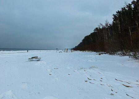 Snowy beach , gulf of Riga, Baltic sea