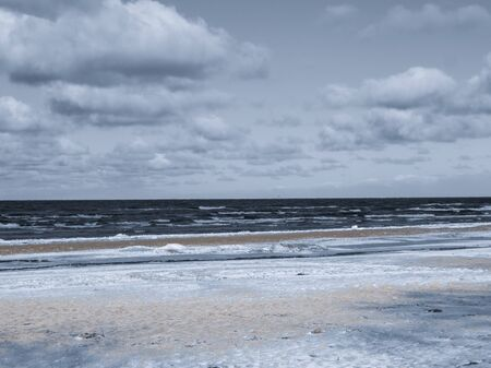 Endless expanses on a snow-covered beach in Jurmala, on the shore of the Gulf of Riga, in winter 2018.Latvia