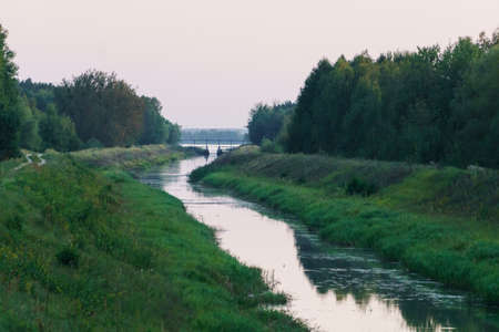 A small river flows from the lake
