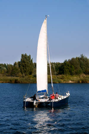 Boat catamaran with sail on the river Lielupe, in Latvia 22 September 2020