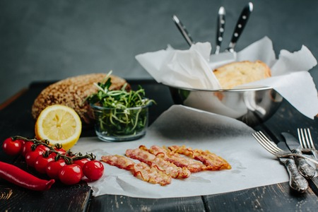 waxed: Four Strips of fried bacon lying on waxed paper on Stock Photo