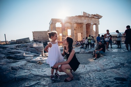 ATHENES, GREECE - AUGUST 10, 2017: group of tourits viewed in the foreground of ancient greek historical monument - Parthenon. Parthenon is a part of Athenian Acropolis. Editöryel