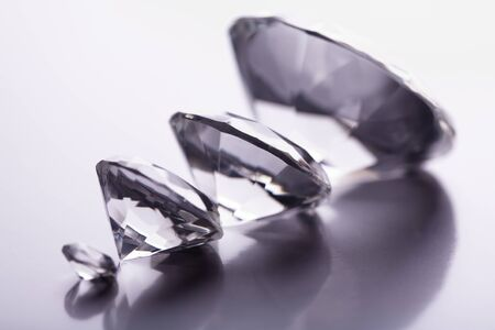 Scaled diamonds on gray background Stock Photo