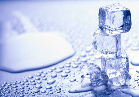 Photo of three melting ice cubes. Close up. Waterdrops in detail. Stok Fotoğraf