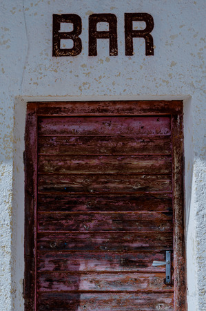 Old weathered door of a mountain bar Stock Photo