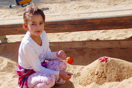 sandpit: Pretty little girl in the sandpit