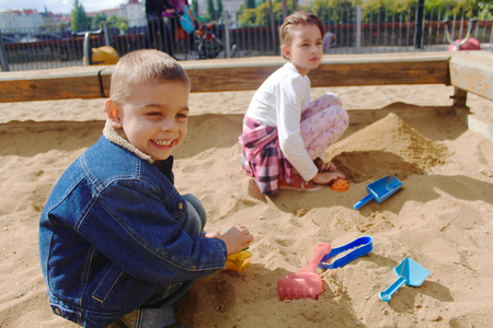 sandpit: Two kids playing together in the sandpit