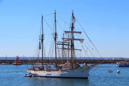 topsail: Sailboat returning to Brest harbor