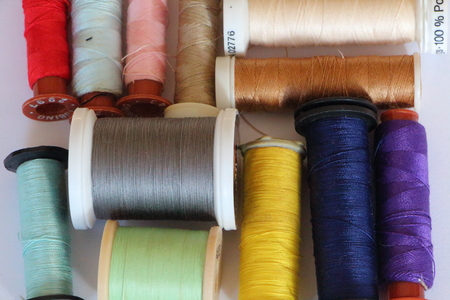 Reels of thread of different colors for sewing Stock Photo
