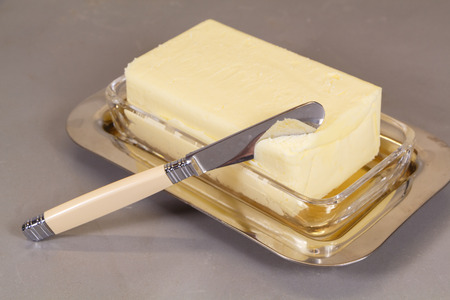 Knife and pack of butter in a butter dish