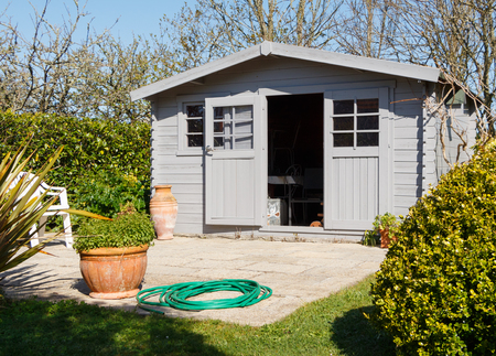 Shed with terrace in a garden during spring Stock Photo