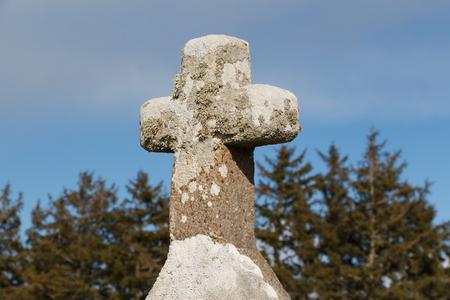 Close-up of granite cross near Notre Dame de Bon Voyage chapel in Plogoff