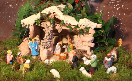 Nativity scene with provencal Christmas crib figures in terracotta and vegetation Foto de archivo